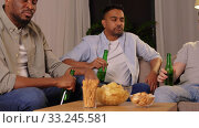 Купить «male friends drinking beer with crisps at home», видеоролик № 33245581, снято 12 января 2020 г. (c) Syda Productions / Фотобанк Лори