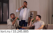 Купить «male friends drinking beer with crisps at home», видеоролик № 33245885, снято 13 января 2020 г. (c) Syda Productions / Фотобанк Лори