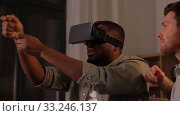 male friends with vr glasses at home at night. Стоковое видео, видеограф Syda Productions / Фотобанк Лори