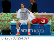 Sofia, Bulgaria - February 10, 2017: Grigor Dimitrov (pictured) from Bulgaria before playing against Viktor Troicki from Serbia during a match from Sofia Open 2017 tennis tournament. Стоковое фото, фотограф Zoonar.com/Cylonphoto / age Fotostock / Фотобанк Лори