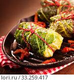 Купить «Cabbage Rolls Served on Cast Iron Pan», фото № 33259417, снято 3 июня 2020 г. (c) PantherMedia / Фотобанк Лори