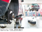 Inside a garage - changing wheels/tires (shallow DOF; color toned image) Стоковое фото, фотограф Viktor Cap / PantherMedia / Фотобанк Лори