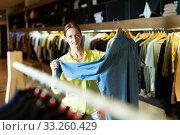 Купить «Fashionable woman buys denim shirt», фото № 33260429, снято 12 июля 2020 г. (c) Яков Филимонов / Фотобанк Лори