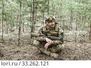 Купить «Handsome man in italian military uniform camouflage coloring Digital Vegetato», фото № 33262121, снято 22 апреля 2017 г. (c) katalinks / Фотобанк Лори