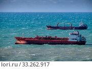 Купить «Краснодарский край, иностранные суда пережидают шторм на внешнем рейде порта Туапсе», фото № 33262917, снято 26 февраля 2020 г. (c) glokaya_kuzdra / Фотобанк Лори