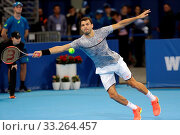 Sofia, Bulgaria - February 10, 2017: Grigor Dimitrov (pictured) from Bulgaria plays against Viktor Troicki from Serbia during a match from Sofia Open 2017 tennis tournament. Стоковое фото, фотограф Zoonar.com/Cylonphoto / age Fotostock / Фотобанк Лори