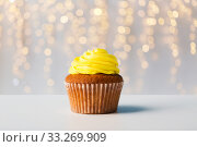 close up of cupcake or muffin with yellow frosting. Стоковое фото, фотограф Syda Productions / Фотобанк Лори