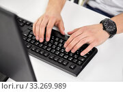 male hands typing on computer keyboard on table. Стоковое фото, фотограф Syda Productions / Фотобанк Лори