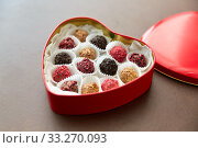 candies in red heart shaped chocolate box. Стоковое фото, фотограф Syda Productions / Фотобанк Лори