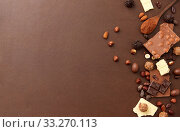 Купить «chocolate with nuts, cocoa beans and powder», фото № 33270113, снято 1 февраля 2019 г. (c) Syda Productions / Фотобанк Лори