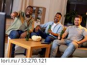 Купить «happy male friends with beer watching tv at home», фото № 33270121, снято 28 декабря 2019 г. (c) Syda Productions / Фотобанк Лори