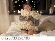 Купить «happy young woman with soft pillow in bed at home», фото № 33270193, снято 19 января 2020 г. (c) Syda Productions / Фотобанк Лори