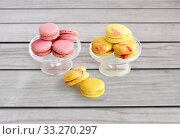 macaroons on glass confectionery stand. Стоковое фото, фотограф Syda Productions / Фотобанк Лори