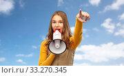 teenage girl speaking to megaphone over sky. Стоковое фото, фотограф Syda Productions / Фотобанк Лори