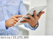 Купить «close up of male hands with tablet pc computer», фото № 33270389, снято 5 апреля 2014 г. (c) Syda Productions / Фотобанк Лори