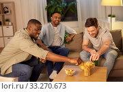 Купить «male friends drinking beer with crisps at home», фото № 33270673, снято 28 декабря 2019 г. (c) Syda Productions / Фотобанк Лори