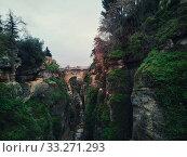 View of rocky canyons and New Bridge of Ronda spanish city, Spain (2019 год). Стоковое фото, фотограф Alexander Tihonovs / Фотобанк Лори