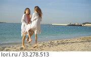Купить «Little happy funny girls have a lot of fun at tropical beach playing together. Sunny day with rain in the sea», видеоролик № 33278513, снято 28 февраля 2020 г. (c) Дмитрий Травников / Фотобанк Лори