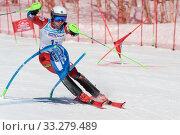 Russian Federation Alpine Skiing Championship, parallel slalom. Sportsman mountain skier Alekhin Nikita Kamchatka skiing down mountain slope (2019 год). Редакционное фото, фотограф А. А. Пирагис / Фотобанк Лори