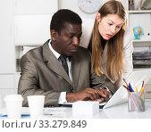Купить «Focused coworkers working together», фото № 33279849, снято 25 мая 2020 г. (c) Яков Филимонов / Фотобанк Лори