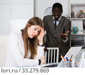Angry male boss screaming to young female manager during working. Стоковое фото, фотограф Яков Филимонов / Фотобанк Лори