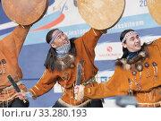 Group aborigine dancer in traditional clothes native people dancing with tambourine. Concert Koryak Dance Ensemble Mengo (2019 год). Редакционное фото, фотограф А. А. Пирагис / Фотобанк Лори