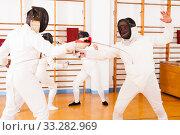 Купить «Fencers exercising techniques in battle», фото № 33282969, снято 11 июля 2018 г. (c) Яков Филимонов / Фотобанк Лори