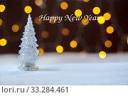 Купить «New Year toy tree against the background of yellow fires. Bokeh, Inscription Happy New Year», фото № 33284461, снято 10 августа 2018 г. (c) Екатерина Кузнецова / Фотобанк Лори