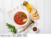 lentil soup with vegetables and lemon wedges. Стоковое фото, фотограф Oksana Zh / Фотобанк Лори