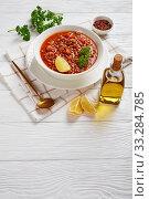 lentil soup with vegetables and lemon wedge. Стоковое фото, фотограф Oksana Zh / Фотобанк Лори
