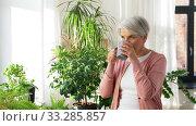 Купить «happy senior woman with cup of tea at home», видеоролик № 33285857, снято 19 января 2020 г. (c) Syda Productions / Фотобанк Лори