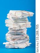 Купить «Tied up foot of briefs on a cyan background.», фото № 33288705, снято 14 июля 2020 г. (c) age Fotostock / Фотобанк Лори