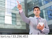 Купить «Businessman pointing at something», фото № 33296453, снято 8 мая 2017 г. (c) Яков Филимонов / Фотобанк Лори