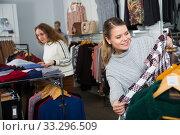 Купить «Women choosing warm coats in boutique», фото № 33296509, снято 6 декабря 2018 г. (c) Яков Филимонов / Фотобанк Лори