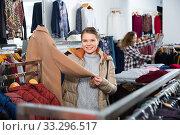 Купить «Woman shopping in outerwear clothing boutique», фото № 33296517, снято 6 декабря 2018 г. (c) Яков Филимонов / Фотобанк Лори
