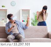 Pair singing karaoke with virtual reality glasses. Стоковое фото, фотограф Elnur / Фотобанк Лори