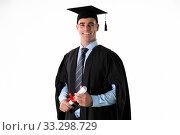 Купить «Caucasian male student holding a certificate graduating», фото № 33298729, снято 2 июля 2019 г. (c) Wavebreak Media / Фотобанк Лори