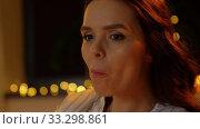 Купить «pregnant woman with popcorn watching tv at home», видеоролик № 33298861, снято 8 февраля 2020 г. (c) Syda Productions / Фотобанк Лори