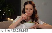Купить «happy smiling pregnant woman eating salad at home», видеоролик № 33298985, снято 8 февраля 2020 г. (c) Syda Productions / Фотобанк Лори