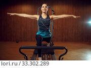 Slim girl keeps the balance, pilates training. Стоковое фото, фотограф Tryapitsyn Sergiy / Фотобанк Лори