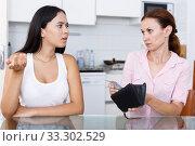 Купить «Girl trying ask money», фото № 33302529, снято 9 июля 2018 г. (c) Яков Филимонов / Фотобанк Лори