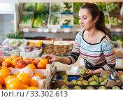 Купить «girl choosing fruits at store», фото № 33302613, снято 20 апреля 2019 г. (c) Яков Филимонов / Фотобанк Лори