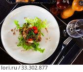 Купить «Cod timbale with roasted red peppers, rocket, olives», фото № 33302877, снято 6 апреля 2020 г. (c) Яков Филимонов / Фотобанк Лори