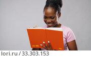 Купить «african american woman with notebook», видеоролик № 33303153, снято 8 февраля 2020 г. (c) Syda Productions / Фотобанк Лори