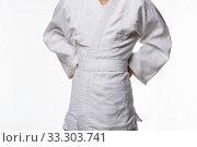 Купить «Stages of correct tying of the belt by a teenager on a sports kimono, step three», фото № 33303741, снято 21 февраля 2020 г. (c) Иванов Алексей / Фотобанк Лори