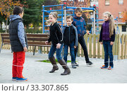 Купить «Kids skipping on chinese jumping elastic rope in yard», фото № 33307865, снято 9 апреля 2020 г. (c) Яков Филимонов / Фотобанк Лори