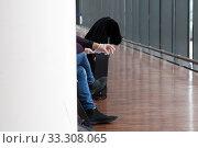 Купить «A passenger wearing disposable gloves waits for flight at the airport», фото № 33308065, снято 29 февраля 2020 г. (c) Юлия Кузнецова / Фотобанк Лори