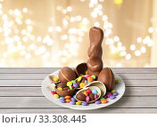 chocolate bunny, eggs and candies over lights. Стоковое фото, фотограф Syda Productions / Фотобанк Лори