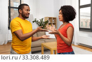 african american couple having argument at home. Стоковое фото, фотограф Syda Productions / Фотобанк Лори