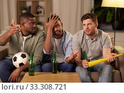 Купить «sad male friends or soccer fans with beer at home», фото № 33308721, снято 28 декабря 2019 г. (c) Syda Productions / Фотобанк Лори